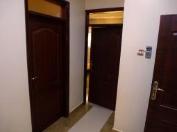 Wash/shower/bedroom antechamber facing bedrooms. Mine is behind the cracked door.