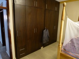 Closets and corner of bed.