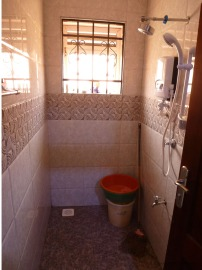 Shower room, also used as clotheswashing room. Green and orange shallow buckets are soap and rinse, others are for water if supply is cut off.